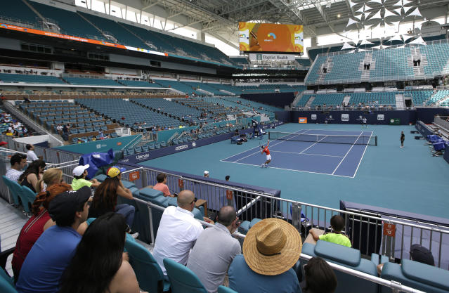 Novak Djokovic practices for the Miami Open tennis tournament at Hard Rock Stadium, Monday, March 18, 2019, in Miami Gardens, Fla. The Miami Open has moved north from its home since 1987, the picturesque island of Key Biscayne, and will begin Tuesday at the home of the Miami Dolphins and the Miami Hurricanes. (AP Photo/Lynne Sladky)