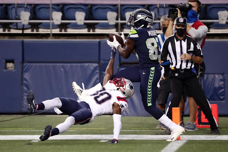 David Moore #83 of the Seattle Seahawks catches a touchdown pass against Jason McCourty #30 of the New England Patriots during the third quarter at CenturyLink Field on September 20, 2020 in Seattle, Washington. (Photo by Abbie Parr/Getty Images)