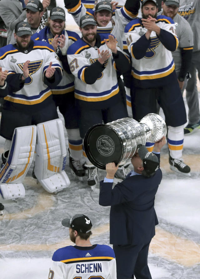 St. Louis Blues head coach Craig Berube kisses the Stanley Cup after the Blues defeated the Boston Bruins in Game 7 of the NHL Stanley Cup Final, Wednesday, June 12, 2019, in Boston. (AP Photo/Charles Krupa)