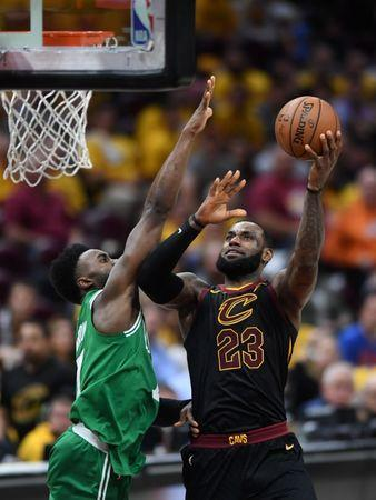 May 21, 2018; Cleveland, OH, USA; Cleveland Cavaliers forward LeBron James (23) attempts a layup in front of Boston Celtics guard Jaylen Brown (7) during the third quarter in game four of the Eastern conference finals of the 2018 NBA Playoffs at Quicken Loans Arena. Mandatory Credit: Ken Blaze-USA TODAY Sports