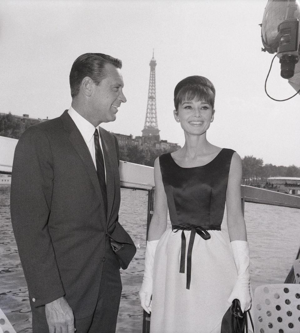 <p>It doesn't get more iconic than Audrey Hepburn posing in front of the Eiffel Tower. The actress was filming <em>Paris When It Sizzles</em> on location with costar William Holden.</p>