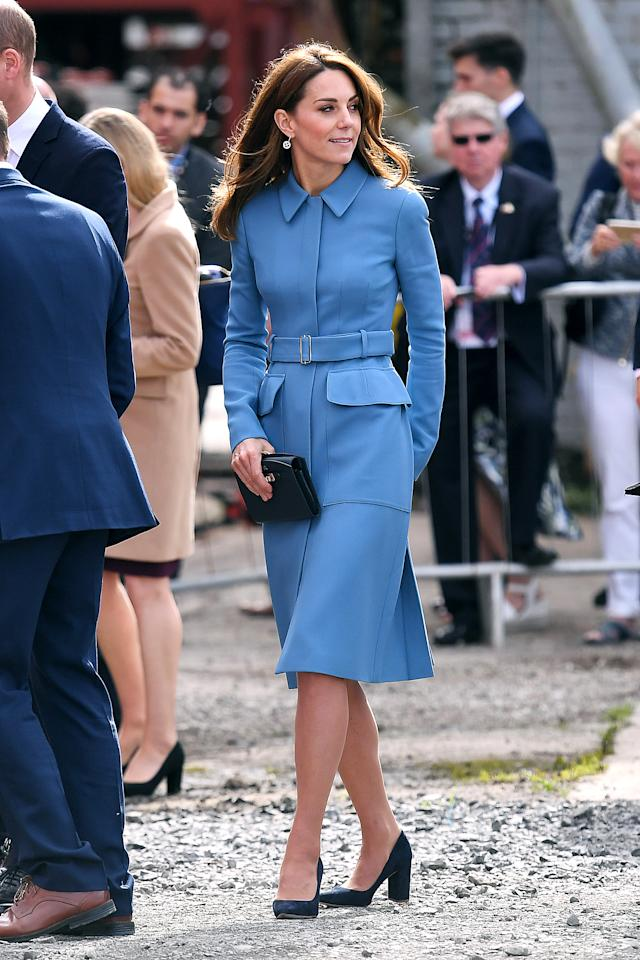 """<p>While <a href=""""https://people.com/royals/kate-middleton-steps-out-in-her-go-to-coat-dress-from-her-wedding-dress-designer-alexander-mcqueen/"""">attending the naming ceremony of the U.K.'s new polar research ship</a>, the RRS Sir David Attenborough, in Birkenhead, Kate recycled her light blue coat dress by Alexander McQueen, which she's worn on several occasions dating back to 2014. She kept the rest of her look simple, wearing black heels and carrying a black clutch by Asprey, with her hair in her signature bouncy blowout.</p>"""