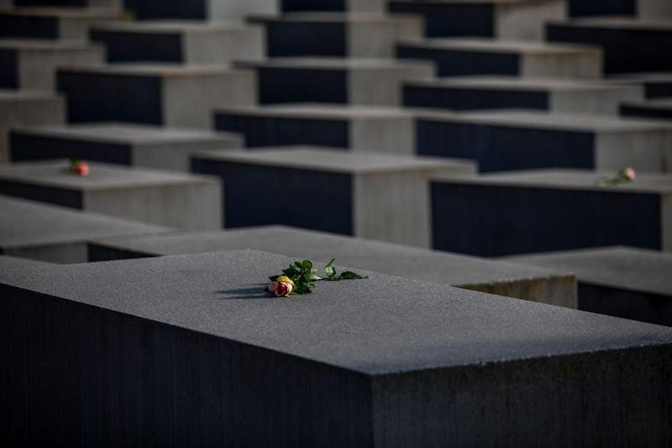 <p>Roses are placed on the Holocaust Memorial on International Holocaust Remembrance Day, 2021, in Berlin, Germany. Today marks the 76th anniversary of the liberation of the Auschwitz</p> (Getty Images)