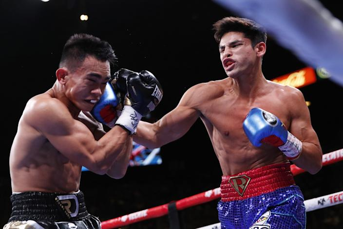 Ryan Garcia, right, punches Romero Duno during their lightweight fight in Las Vegas in November 2019.