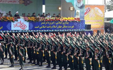Iran's Revolutionary Guard Corps marching at an annual parade in Tehran - Credit: AFP