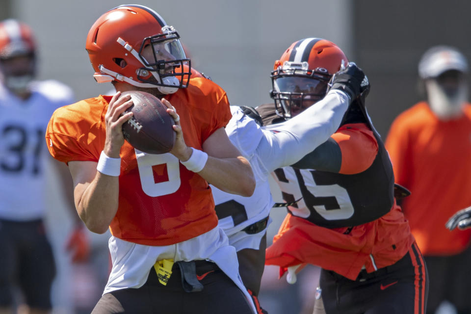 Cleveland Browns quarterback Baker Mayfield (6) looks downfield during an NFL football practice in Berea, Ohio, Wednesday, Aug. 4, 2021. (AP Photo/David Dermer)