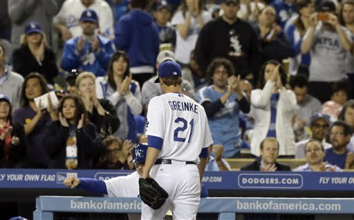 Los Angeles Dodgers starting pitcher Zack Greinke comes out of the game against the Washington Nationals in the sixth inning of a baseball game in Los Angeles Wednesday, May 15, 2013. (AP Photo/Reed Saxon)