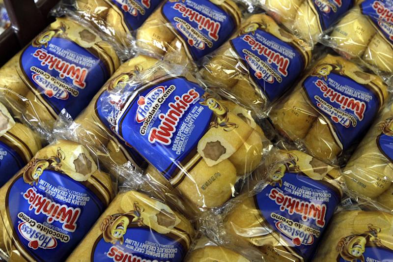 FILE - In this Friday, Nov. 16, 2013, file photo, Twinkies baked goods are displayed for sale at the Hostess Brands' bakery in Denver, Colo. Hostess annoucned on Thursday, Jan. 31, 2013, it has picked a lead bidder for its famous Twinkies. The bankrupt company said late Wednesday, Jan. 30, 2013,  that it has selected a joint offer from two investment firms, C. Dean Metropoulos & Co. and Apollo Global Management LLC,  as the lead bid for its Twinkies and other snack cakes.. (AP Photo/Brennan Linsley, File)