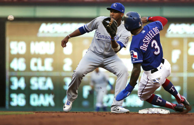 Texas Rangers left fielder Delino DeShields (3) tries to steal second base as Kansas City Royals shortstop Alcides Escobar (2) waits for the throw during the first inning of a baseball game Thursday, May 24, 2018, in Arlington, Texas. DeShields was called out on the play. (AP Photo/Ron Jenkins)