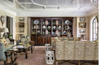 """<p>""""This room has wonderful symmetry, which made it possible for us to add architectural pattern on the ceiling. Here, I designed a fretwork motif reminiscent of Chippendale cabinets; we lacquered it in white for further effect.""""</p><p>A tightly patterned antique carpet unifies the room. Its warm reds are picked up in the accent pillows and the sandy hues repeated in the sofas, which are upholstered in a cut velvet tiger pattern (Cowtan & Tout). </p>"""