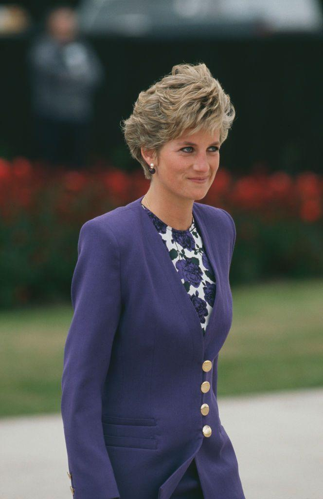 <p>The Princess had a purple-on-purple moment in this look, worn at Heathrow Airport in April 1991. </p>