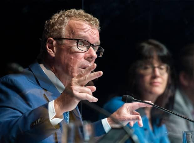 Labour Minister Jean Boulet says the government is recommending that private sector employers develop similar plans to return to offices this fall. (Graham Hughes/The Canadian Press - image credit)
