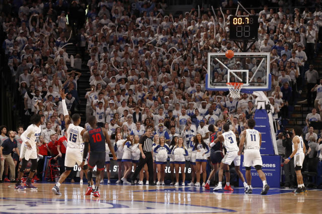 Dayton's Jalen Crutcher (10) watches as his basket falls with less than a second left in overtime to give the team a 78-76 win over Saint Louis in an NCAA college basketball game Friday, Jan. 17, 2020, in St. Louis. (AP Photo/Jeff Roberson)