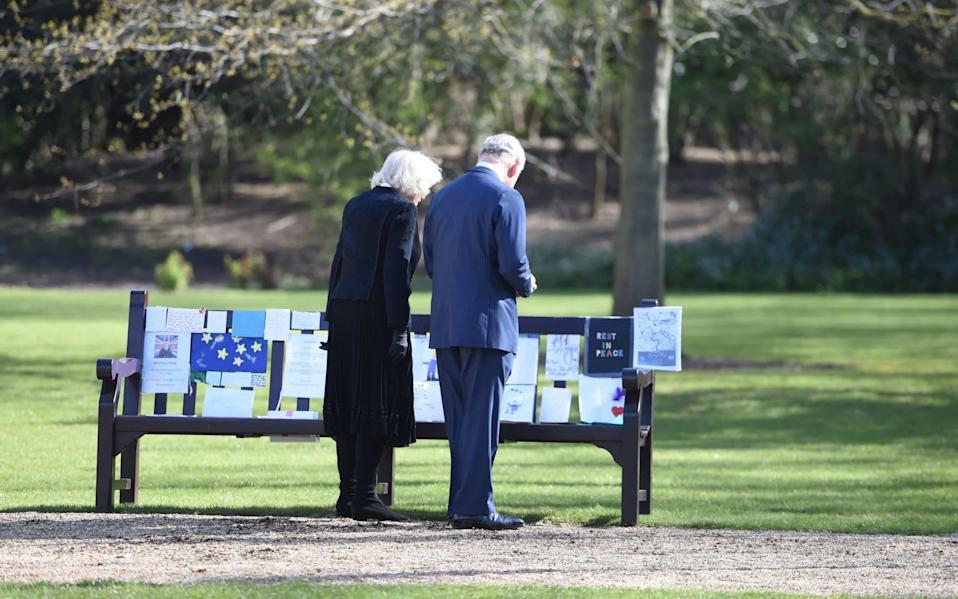 The Prince of Wales and the Duchess of Cornwall visit the gardens of Marlborough House, London, to view the flowers and messages left by members of the public outside Buckingham Palace - Jeremy Selwyn