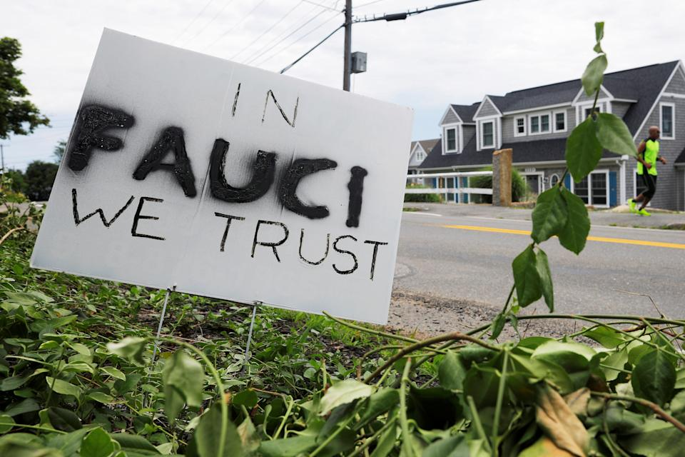"A sign reads ""In Fauci We Trust,"" referring to the director of the National Institute of Allergy and Infectious Diseases Anthony Fauci, outside a home in Rockport, Massachusetts, U.S., July 13, 2020.   REUTERS/Brian Snyder"