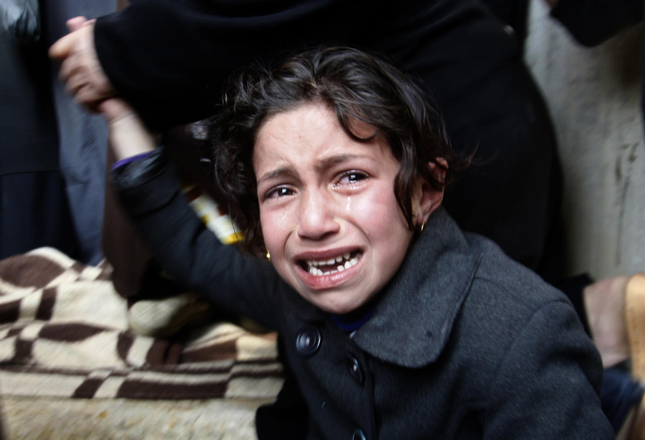 Palestinian girl cries during the funeral of a 12 year old Ayoub Assalya in Jabaliya Refugee Camp, in Gaza Strip, Sunday, March 11, 2012. The worst round of violence in more than a year between Israel and Gaza Strip Palestinians deepened Sunday with deadly Israeli airstrikes and a barrage of rockets fired into the Jewish state. (AP Photo/Hatem Moussa)
