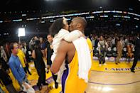 Kobe Bryant #24 of the Los Angeles Lakers kisses his daughter Gianna after converting a last-second shot to defeat the Sacramento Kings 109-108 at Staples Center on January 1, 2010 in Los Angeles, California. (Photo by Noah Graham/NBAE via Getty Images)