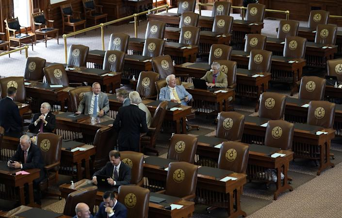 Empty seats are left in the House chamber at the Capitol on July 13. Texas Democrats left the state the day before to block sweeping new election laws, and Gov. Greg Abbott threatened them with arrest the moment they return.