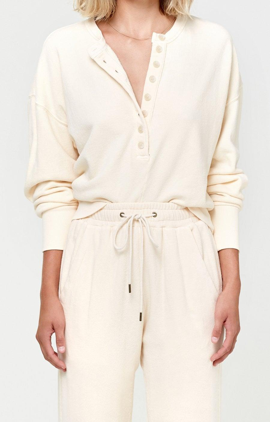 """<p>""""Citizens just launched loungewear and it's all I want to wear. I love this <span>Citizens of Humanity Cora Henley Sweatshirt in Twilight</span> ($178) with denim or as a matching set."""" - DAC</p>"""