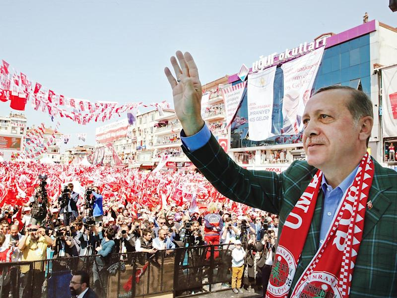 Turkish President Recep Tayyip Erdogan waving to supporters during a 'Vote Yes' rally in Istanbul, Turkey (EPA)