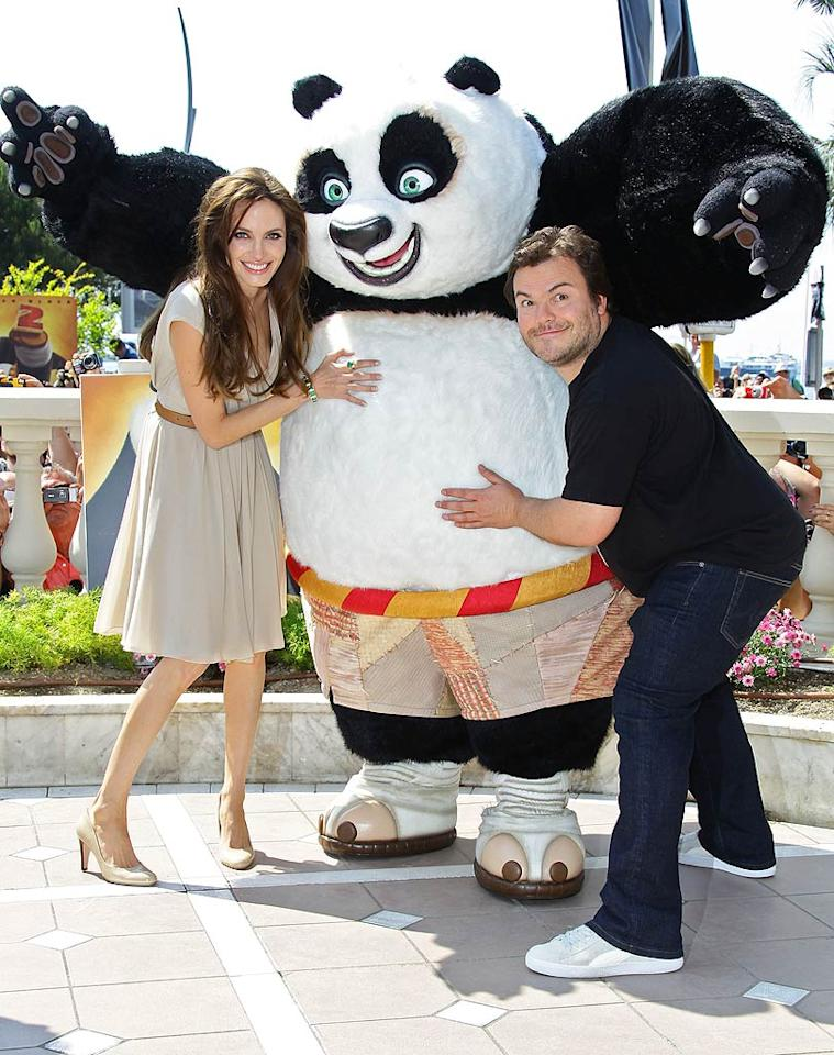 "Angelina Jolie and Jack Black, the voices behind ""Kung Fu Panda 2,"" got goofy with the <i>real</i> star of the film during the Cannes Film Festival. Vittorio Zunino Celotto/<a href=""http://www.gettyimages.com/"" target=""new"">GettyImages.com</a> - May 12, 2011"