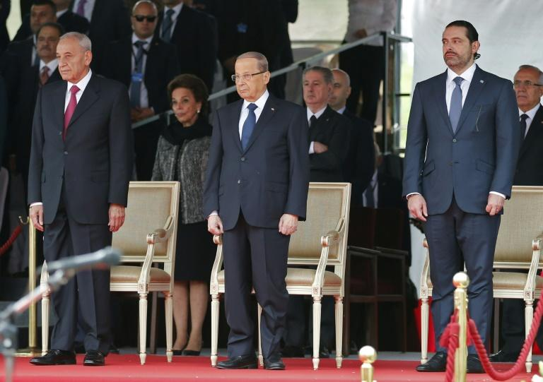 Lebanese Prime Minister Saad Hariri (R), President Michel Aoun (C) and parliament speaker Nabih Berri attend a military parade to celebrate the 74th anniversary of Lebanon's independence in downtown Beirut