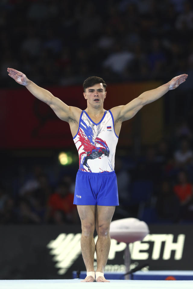 Artur Dalaloyan of Russia performs on the floor in the men's team final at the Gymnastics World Championships in Stuttgart, Germany, Wednesday, Oct. 9, 2019. (AP Photo/Matthias Schrader)