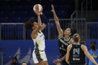 Dallas Wings forward Satou Sabally (0) looks to pass the ball against Chicago Sky center Candace Parker (3) during the first half in the first round of the WNBA basketball playoffs, Thursday, Sept. 23, 2021, in Chicago. (AP Photo/Kamil Krzaczynski)