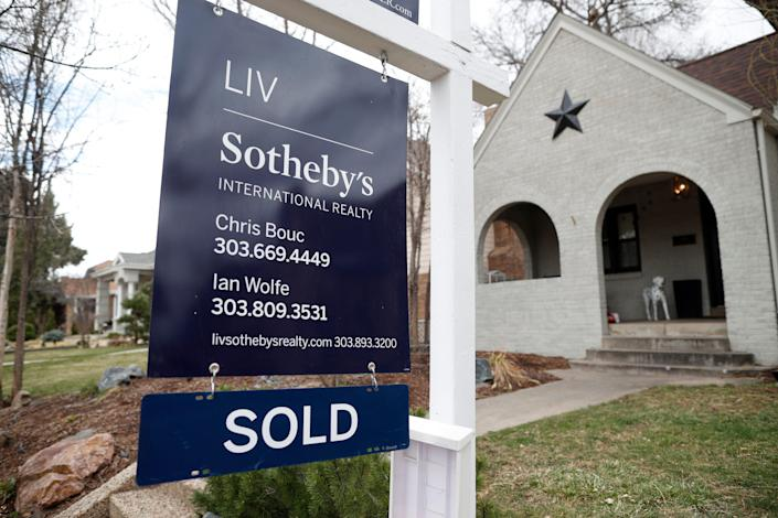 A sold sign is shown outside a single-family home on the market in Denver. On Thursday, May 24, the National Association of Realtors reports on April sales of existing homes.