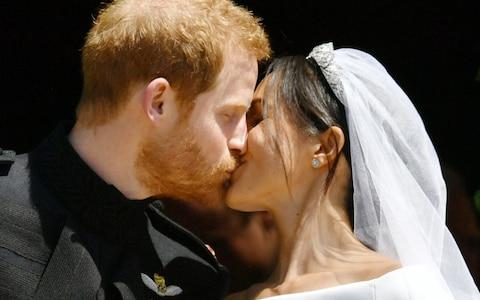 A kiss as they leave St George's Chapel as husband and wife - Credit: PA