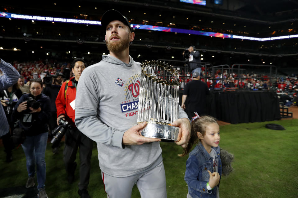 HOUSTON, TX - OCTOBER 30:  Stephen Strasburg #37 of the Washington Nationals celebrates with the Commissioner's Trophy after the Nationals defeated the Houston Astros in Game 7 to win the 2019 World Series at Minute Maid Park on Wednesday, October 30, 2019 in Houston, Texas. (Photo by Rob Tringali/MLB Photos via Getty Images)