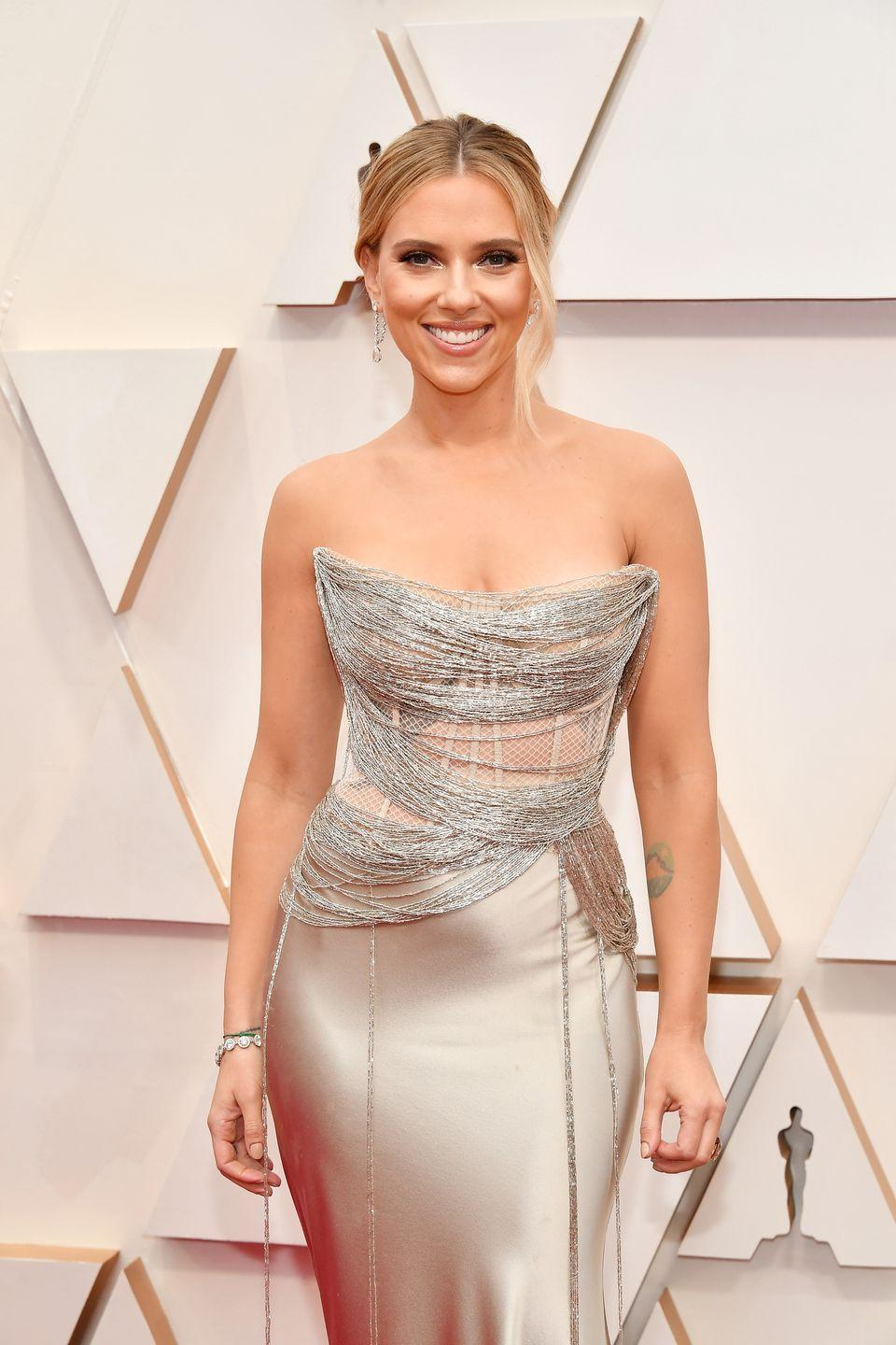 """<p>Scarlett Johansson had nearly 15 years of acting experience when she released <a href=""""https://open.spotify.com/album/2bBRv5VJOPSIHmSMhzfHXm?si=bIJGgbosQT6sjPY_KwWISQ"""" rel=""""nofollow noopener"""" target=""""_blank"""" data-ylk=""""slk:Anywhere I Lay My Head"""" class=""""link rapid-noclick-resp""""><em>Anywhere I Lay My Head</em></a>. Her beautifully haunting alto voice is accompanied by impressive instrumentals, but it was her subsequent projects that really caught the music world's attention. In 2009, she teamed up with her <a href=""""https://www.thewrap.com/scarlett-johansson-leaves-manager-rick-yorn-two-decades-exclusive/"""" rel=""""nofollow noopener"""" target=""""_blank"""" data-ylk=""""slk:former manager"""" class=""""link rapid-noclick-resp"""">former manager</a>'s son, musician Pete Yorn, on <a href=""""https://open.spotify.com/album/24mEKo2SeIgyfdAlyCvI0H?si=H4THHehMQ42JuvoDN7qmoA"""" rel=""""nofollow noopener"""" target=""""_blank"""" data-ylk=""""slk:Break Up"""" class=""""link rapid-noclick-resp""""><em>Break Up</em></a>. They reunited nine years later for <a href=""""https://open.spotify.com/album/19Kj3VuXLp7tCRWqq0h4l3?si=jPzc6c7fQS6BW3qkAIPBrg"""" rel=""""nofollow noopener"""" target=""""_blank"""" data-ylk=""""slk:Apart"""" class=""""link rapid-noclick-resp""""><em>Apart</em></a>.</p>"""