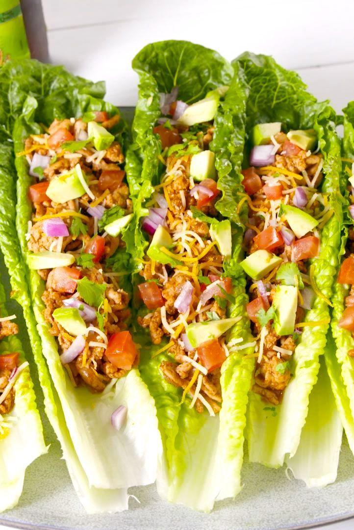 """<p>Pro tip: Use double the romaine for extra-sturdy boats.</p><p>Get the recipe from <a href=""""https://www.delish.com/cooking/recipe-ideas/a20964799/turkey-taco-lettuce-wraps-recipe/"""" rel=""""nofollow noopener"""" target=""""_blank"""" data-ylk=""""slk:Delish"""" class=""""link rapid-noclick-resp"""">Delish</a>.</p>"""