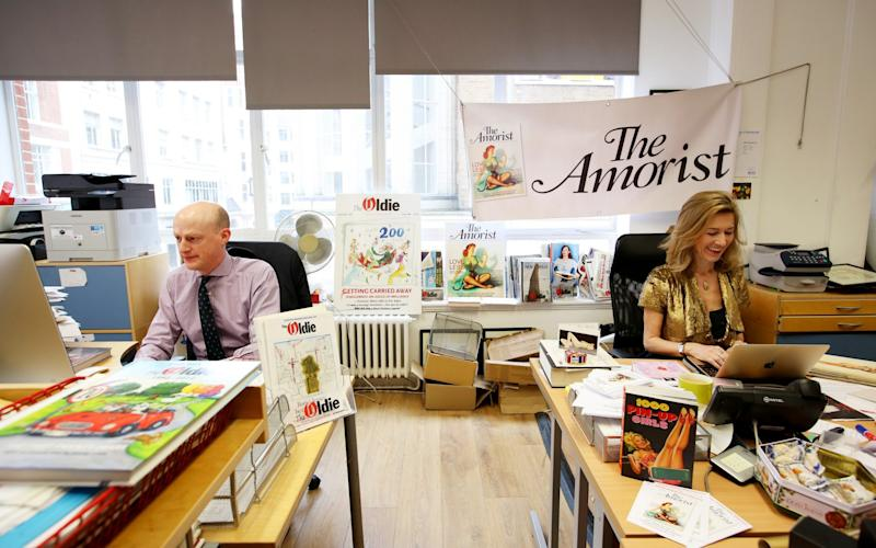 Rowan Pelling at her desk in the central London office of her new magazine, The Amorist, which shares an office room with The Oldie magazine, edited by Harry Mount  - Credit: Clara Molden/The Telegraph