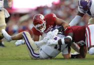 Oklahoma defensive end Reggie Grimes (14) and defensive lineman Perrion Winfrey (8) tackle Western Carolina quarterback Rogan Wells (11) during the first half of an NCAA college football game Saturday, Sept. 11, 2021, in Norman, Okla. (AP Photo/Alonzo Adams)