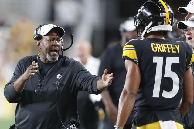 In this photo from Friday, Aug. 9, 2019, Pittsburgh Steelers wide receivers coach Darryl Drake, left talks to wide receiver Trey Griffey (15) during the second half of an NFL preseason football game against the Tampa Bay Buccaneers in Pittsburgh. The team said Drake, who joined the coaching staff in 2018, died early Sunday morning, Aug. 12, 2019. (AP Photo/Keith Srakocic)