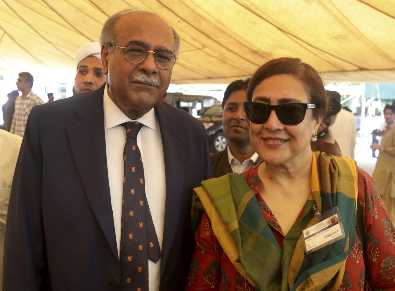 "In this Wednesday, Aug. 15, 2018 photo, Pakistan Cricket Board chairman Najam Sethi arrives at the Punjab Assembly with his wife Jugno in Lahore, Pakistan. Sethi resigned as the Pakistan Cricket Board chairman on Monday, Aug. 20, 2018, just two days after Imran Khan was sworn in as country's prime minister. ""In order to facilitate your objectives in the interest of Pakistan cricket, I hereby submit my resignation as chairman of PCB and Member of its BoG (Board of Governor),"" Sethi wrote in his letter to Khan. (AP Photo/K.M. Chaudary)"