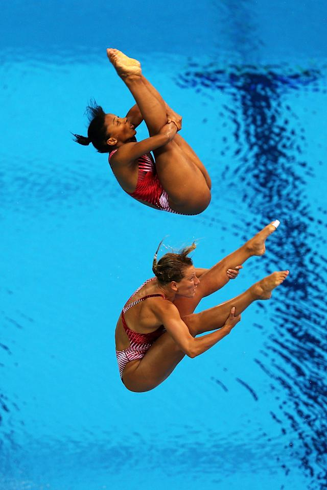 LONDON, ENGLAND - JULY 29: Emilie Heymans (Bottom) and Jennifer Abel of Canada compete in the Women's Synchronised 3m Springboard final on Day 2 of the London 2012 Olympic Games at the Aquatics Centre at Aquatics Centre on July 29, 2012 in London, England.  (Photo by Clive Rose/Getty Images)