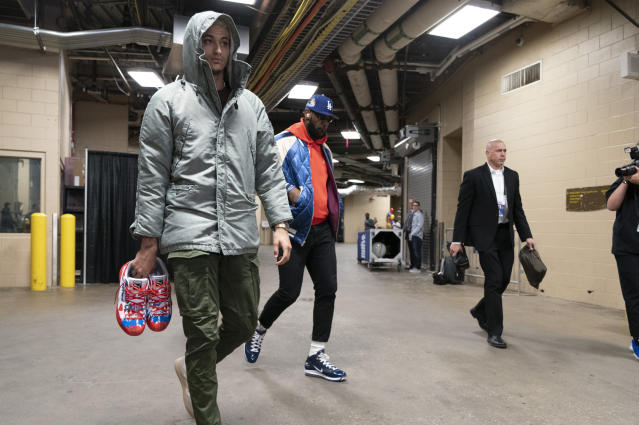 Los Angeles Lakers' Kyle Kuzma, left, and LeBron James, right, walk into the arena prior to the first half of an NBA basketball game against the Philadelphia 76ers, Saturday, Jan. 25, 2020, in Philadelphia. (AP Photo/Chris Szagola)