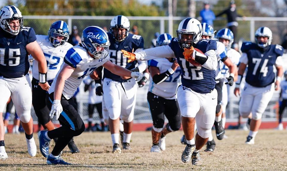 Venice running back Darion Tyler (12) looks for room to run against Palisades on Friday.