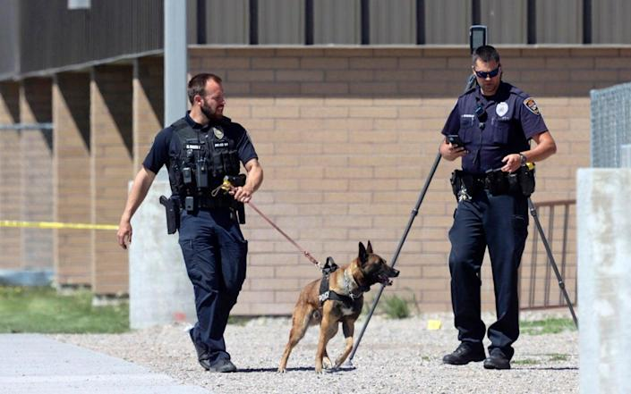 Police patrol the outside of Rigby Middle School following a shooting there - Natalie Behring