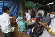 A health worker administers the Covishield vaccine during a special vaccination drive against COVID-19 in Hyderabad, India, Friday, June 25, 2021. (AP Photo/Mahesh Kumar A.)