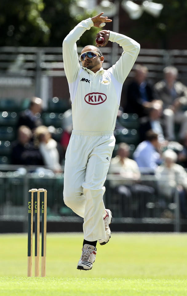 GUILDFORD, ENGLAND - JULY 11: Murali Kartik of Surrey bowls during the LV County Championship match between Surrey and Lancashire at Guildford Cricket Club on July 11, 2012 in Guildford, England. (Photo by Ben Hoskins/Getty Images)