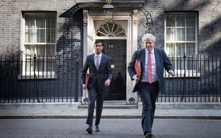 Chancellor Rishi Sunak and the PM leave 10 Downing Street for the meeting - PA