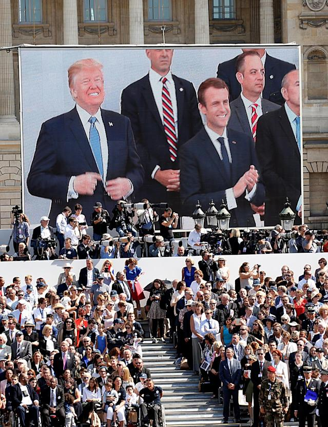 <p>President Donald Trump and French President Emmanuel Macron are seen on a giant screen on the Place de la Concorde as they attend the traditional Bastille Day military parade on the Champs-Elysees in Paris, France, July 14, 2017. (Photo: Kevin Lamarque/Reuters) </p>