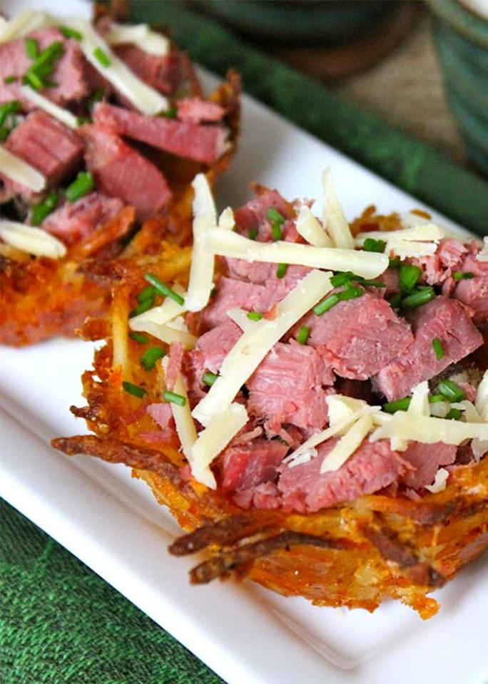 "Crispy <a rel=""nofollow"" href=""https://leaandjay.wordpress.com/2015/03/14/corned-beef-irish-cheddar-potato-nests-with-spicy-horseradish-cream-guinness-mustard/"" rel="""">potato cups</a> cradle shredded corned beef and Irish cheddar cheese in this recipe."