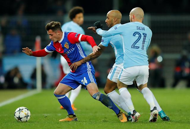 Soccer Football - Champions League - Basel vs Manchester City - St. Jakob-Park, Basel, Switzerland - February 13, 2018 Basel's Taulant Xhaka in action with Manchester City's Fabian Delph and David Silva REUTERS/Denis Balibouse