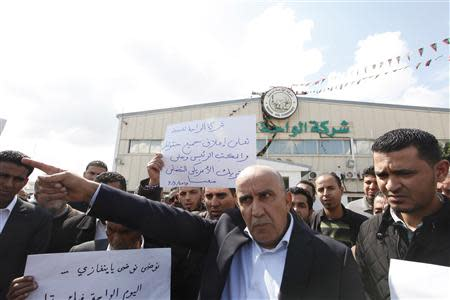 Staff at Libya's Waha Oil Company go on strike in Tripoli to protest against the sale of oil at the Es Sider port, which had been seized by armed protesters, March 9, 2014. REUTERS/Ismail Zitouny