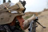 FILE PHOTO: U.S. Marine gestures during an operation in Marjah, Helmand province