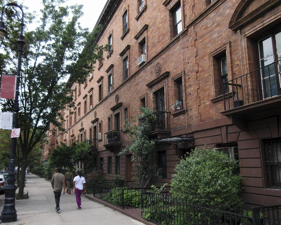 FILE - In this June 25, 2015 file photo, trees line a quiet streetscape in the St. Nicholas Historic District, also known as Strivers Row, in the Harlem section of New York. A Massachusetts Institute of Technology project called Treepedia, that maps trees in the world's major cities, is making it easier to determine where more green is needed. Trees play a critical role in urban environments, helping keep cities cool, mitigating air and noise pollution and just making them more pleasant places to live and work. (AP Photo/Beth J. Harpaz, File)